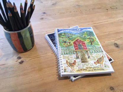 Hannah Dunnett Under His Wings notebook closeup image