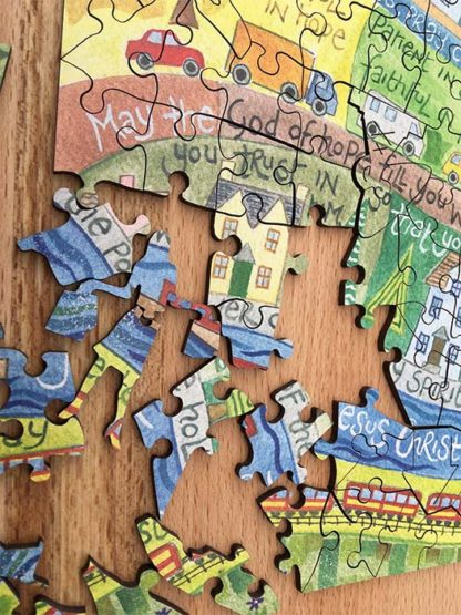 Hannah Dunnett He Cares For You Jigsaw pieces super close up image